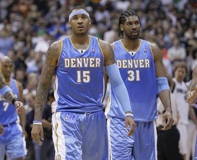 Denver Nuggets forward Carmelo Anthony (15) and Denver Nuggets center Nene (31) are two key players in the Nuggets series against the Lakers. (AP Photo)
