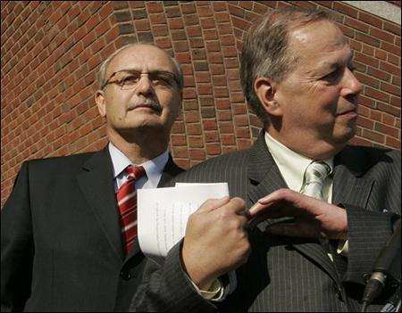 Former Massachusetts House Speaker Salvatore DiMasi, left, leaves federal court as his attorney Thomas Kiley, right, speaks briefly to reporters after DiMasi was indicted on federal corruption charges in Boston, Tuesday. (AP Photo)