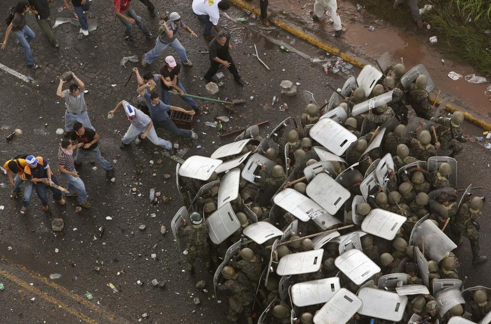Supporters of ousted Honduran President Manuel Zelaya clash with soldiers in Tegucigalpa, Monday, June 29. 2009.(AP)
