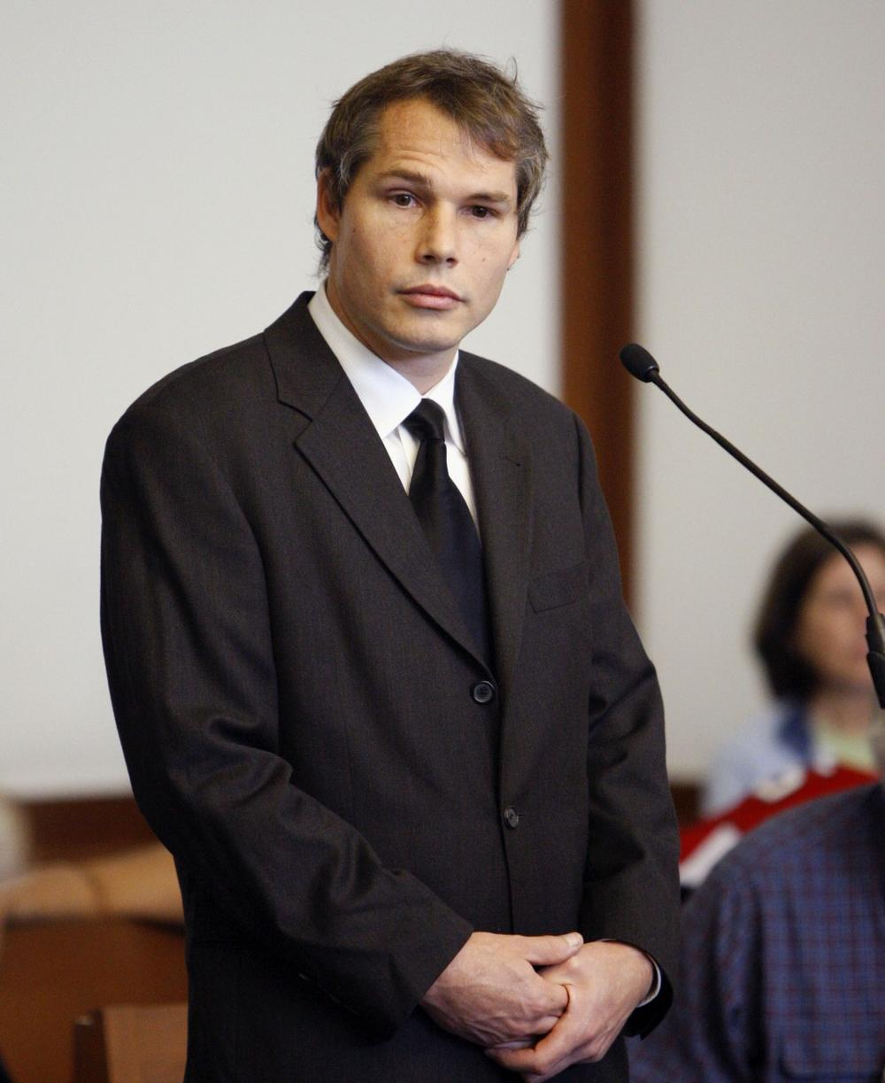 Artist Shepard Fairey stands in Boston Municipal Court on Friday during a status hearing in connection with 13 vandalism charges around Boston. (AP Photo)