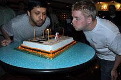 HubSpot CTO and co-founder Dharmesh Shah and developer Patrick Fitzsimmons blow out candles at a bowling party celebrating the online marketing company's third birthday. (Courtesy of Kyle James)