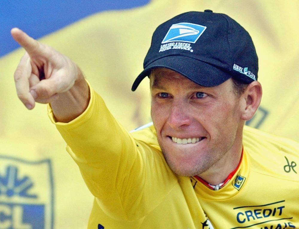 Lance Armstrong celebrates on the podium after winning the 15th stage of the Tour de France cycling race between Bagneres-de-Bigorre and Luz-Ardiden, French Pyrenees, Monday, July 21, 2003. (AP Photo/Christophe Ena)