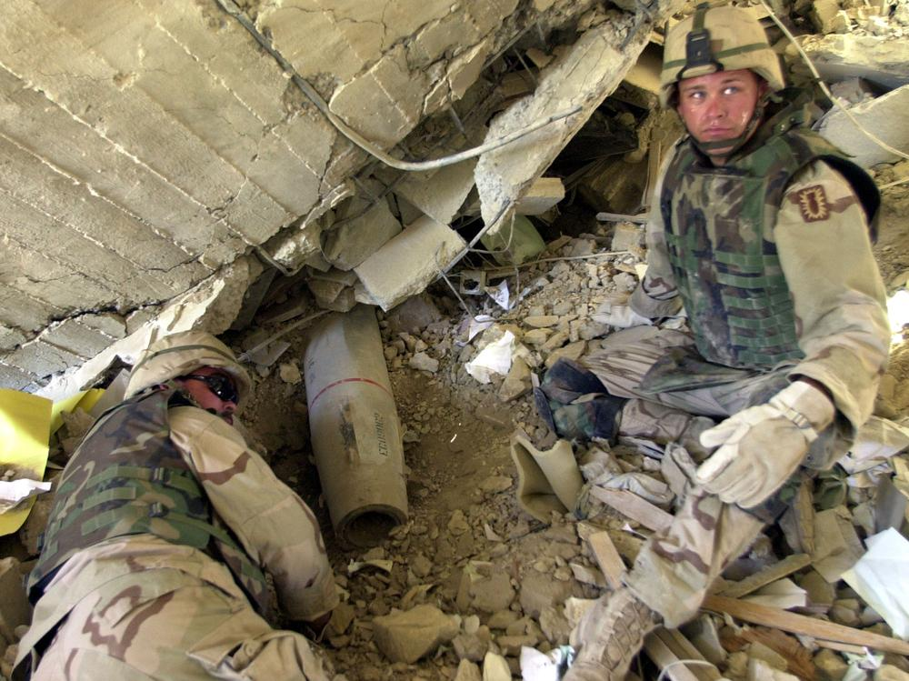 Members of an explosive ordinance disposal team unearth a missile on May 9, 2003 in Baghdad, Iraq. (AP)