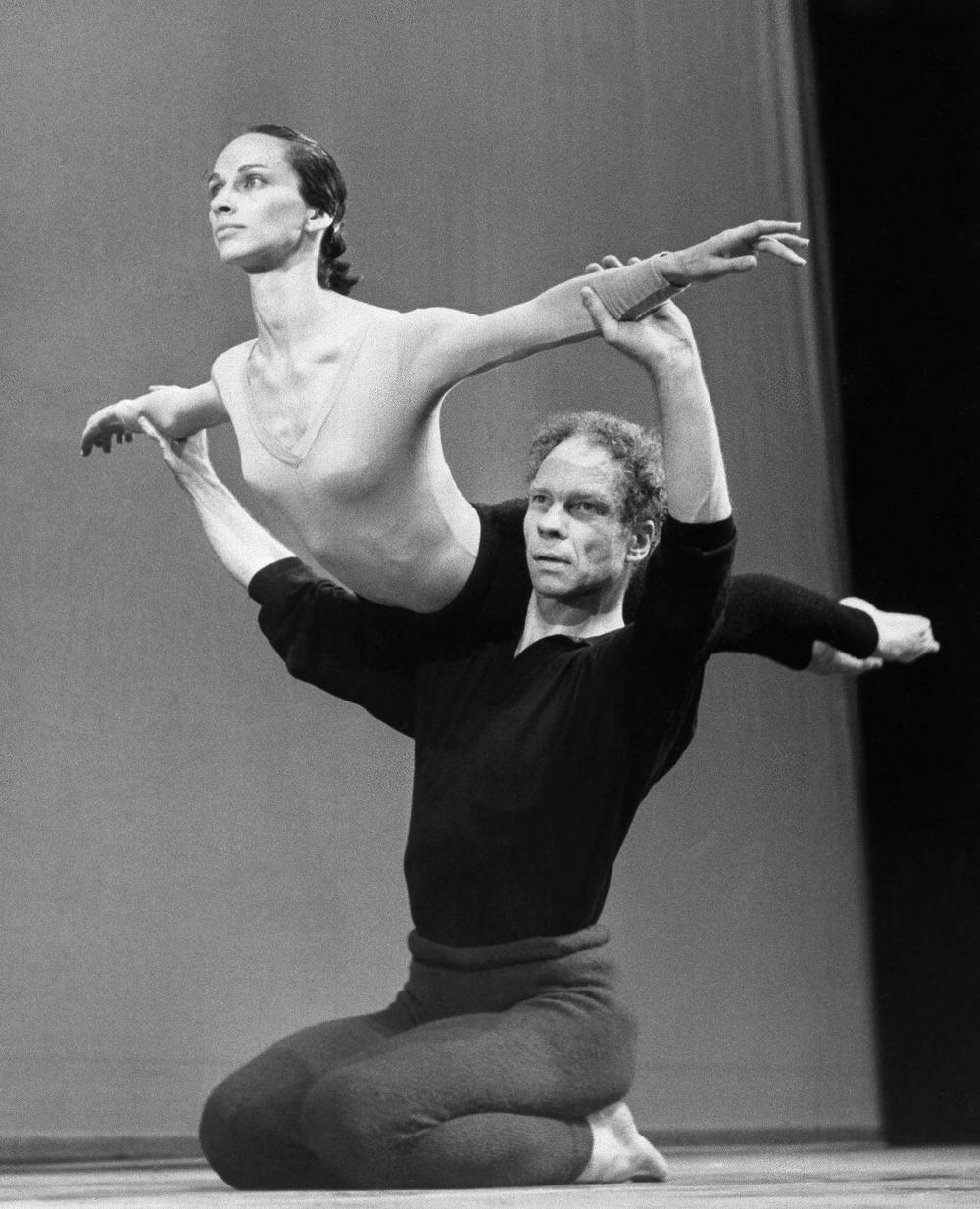In this 1964 file photo, Merce Cunningham lifts Carolyn Brown during rehearsal at Sadler Wells Theater in London, England. (AP)