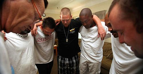 Members of a discussion group for drug and alcohol abusers at the Sacramento Recovery House, in Sacramento, Calif., gather in a circle for a serenity prayer at the end of a meeting on July 29, 2009. (AP)
