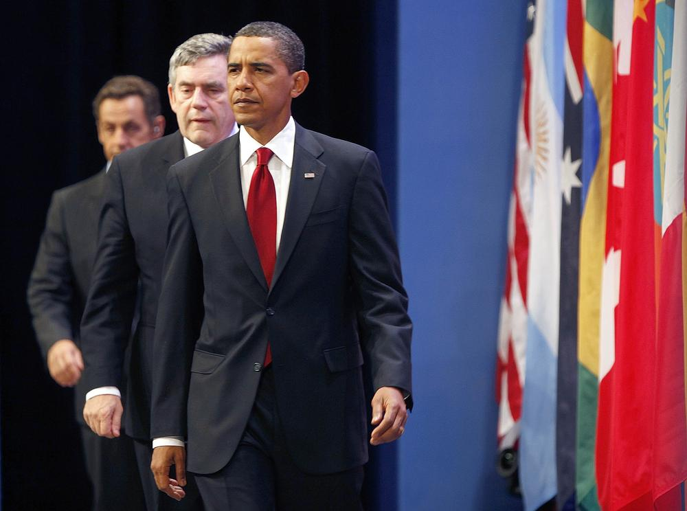 President Barack Obama, followed by British Prime Minister Gordon Brown, center, and French President Nicolas Sarkozy, arrive to make a statement on Iran's nuclear facility, Friday, Sept. 25, 2009. (AP)