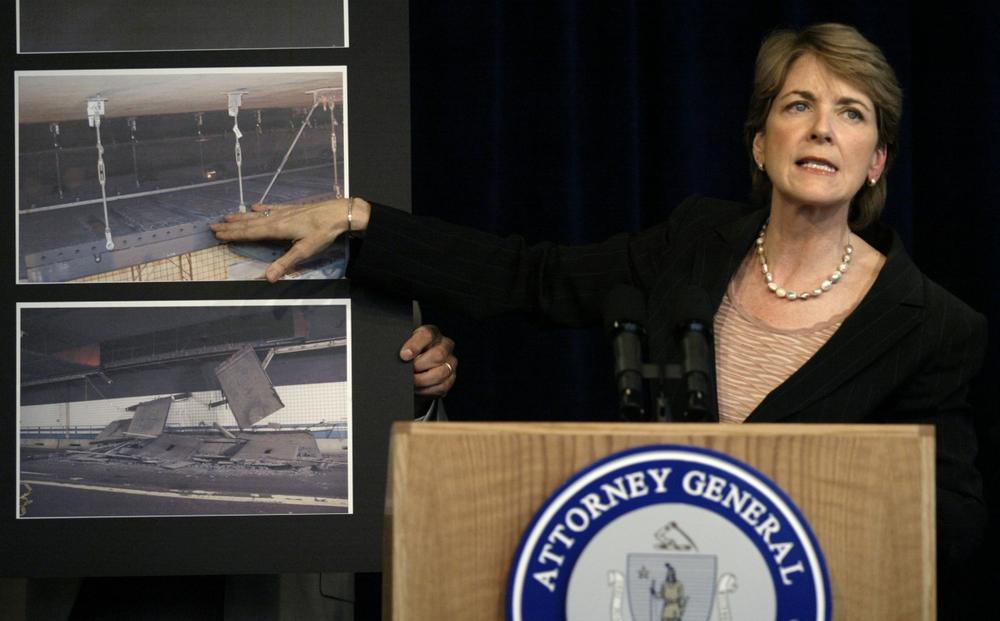 Coakley talks about pictures of the 2006 Big Dig tunnel collapse during a news conference on the incident in Aug. 2007. (AP)