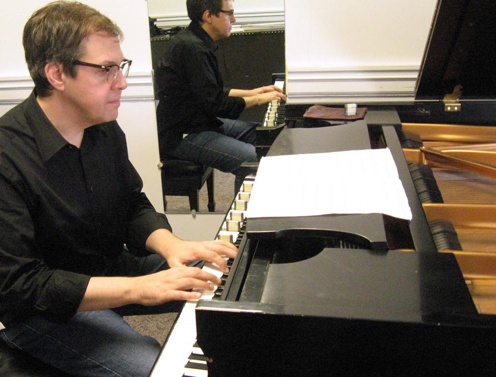 On his new CD, Bruce Brubaker used small metal weights, at left, to change the piano's hue. The difference is very subtle, but Brubaker says it excites him because it's mysterious. (Andrea Shea/WBUR)