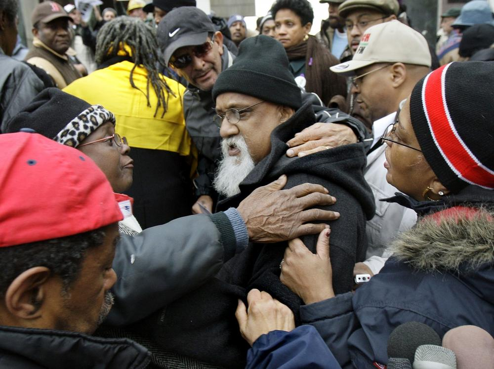 Turner is embraced by supporters after a November news conference in which he accused the media of violating his rights and assuming his guilt. (AP)