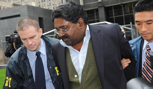 Raj Rajaratnam, billionaire founder of the Galleon Group, a major hedge fund, is led in handcuffs from FBI headquarters in New York on Friday, Oct.16, 2009. Rajaratnam was charged with insider trading in the stock of several companies including Hilton, Clearwire, and Google. (AP)