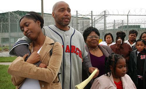 Terry Harrington, center, stands with his daughter Nicole Brown, left, his mother Josephine James, right, and family and friends outside the Clarinda Correctional Facility after Iowa Gov. Tom Vilsack signed a reprieve for Harrington, Thursday April 17, 2003.