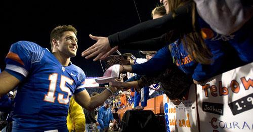 Florida quarterback Tim Tebow makes the trip around the Swamp greeting fans for the last time after Florida defeated Florida State in Gainesville, Fla., Saturday, Nov. 28, 2009. (AP)
