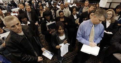 Job seekers attend a job fair in Livonia, Mich., Wednesday, Nov. 4, 2009. (AP)