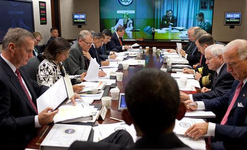 President Barack Obama and his national security team listen to a presentation from Karl W. Eikenberry, U.S. Ambassador to Afghanistan, during a briefing on Afghanistan and Pakistan in the Situation Room of the White House Wednesday, Oct. 14, 2009. (AP/White House)