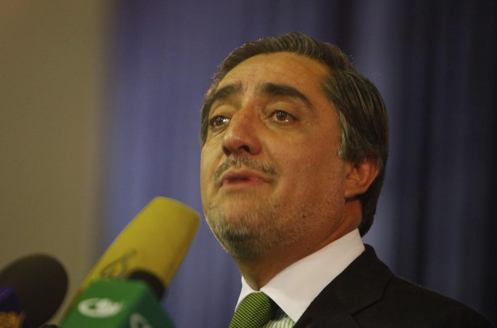 Afghanistan's presidential challenger Abdullah Abdullah announces his decision not to participate in Afghanistan's run-off election during a press conference in Kabul, Afghanistan, Sunday.  (AP /Gemunu Amarasinghe)