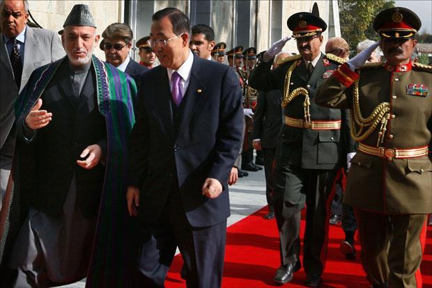 Afghan President Hamid Karzai speaks with the U.N. Secretary-General Ban Ki-moon at the presidential palace in Kabul. (Musadeq Sadeq/AP)
