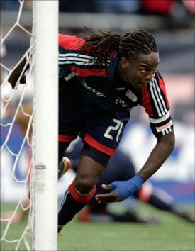 Shalrie Joseph celebrates his goal against the Chicago Fire during the second half the game on Sunday. (Adam Hunger/AP)