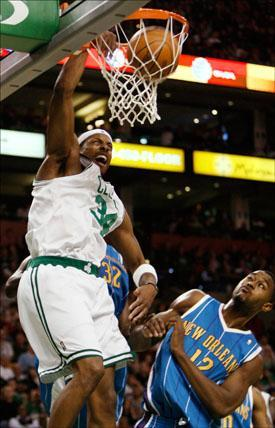Boston Celtics forward Paul Pierce dunks on New Orleans Hornets center Hilton Armstrong during the first half of the game on Sunday. (Winslow Townson/AP)