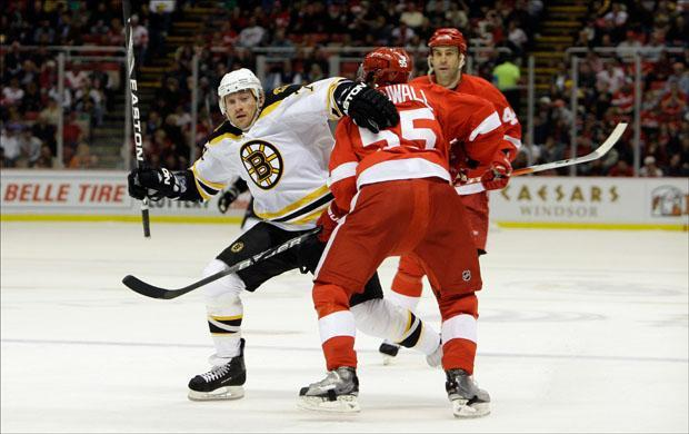 Bruins Michael Ryder skates around Detroit Red Wings defender Niklas Kronwall in the second period of a game on Tuesday. (Paul Sancya/AP)