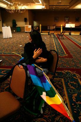 Friends console one another after learning about the unofficial defeat on Question 1 at an empty election night headquarters in Portland, Maine. (Pat Wellenbach/AP)