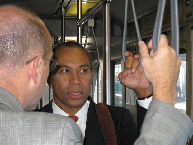 Gov. Deval Patrick rode the T to the airport on Wednesday after a news conference to discuss a scathing new review of the MBTA. (Meghna Chakrabarti/WBUR)