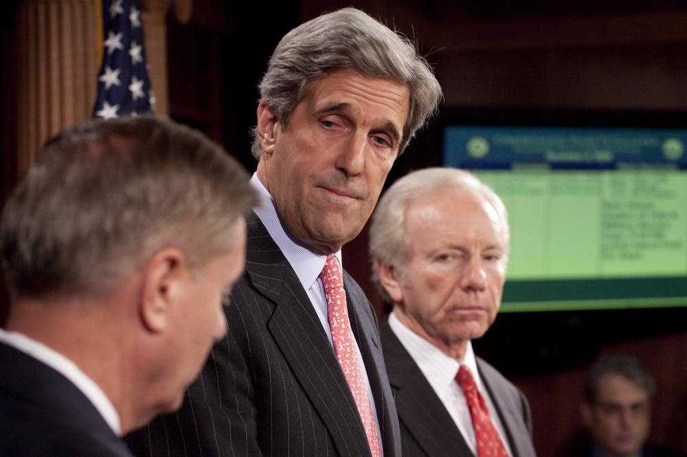Sen. John Kerry, accompanied by Sen. Lindsey Graham, left, and Sen. Joseph Lieberman, takes part in a news conference on Capitol Hill in Washington, Wednesday, to discuss climate change legislation. (AP)