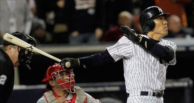 Hideki Matsui watches his two run RBI double during the fifth inning of Game 6 of the World Series on Wednesday. (David J. Phillip/AP)