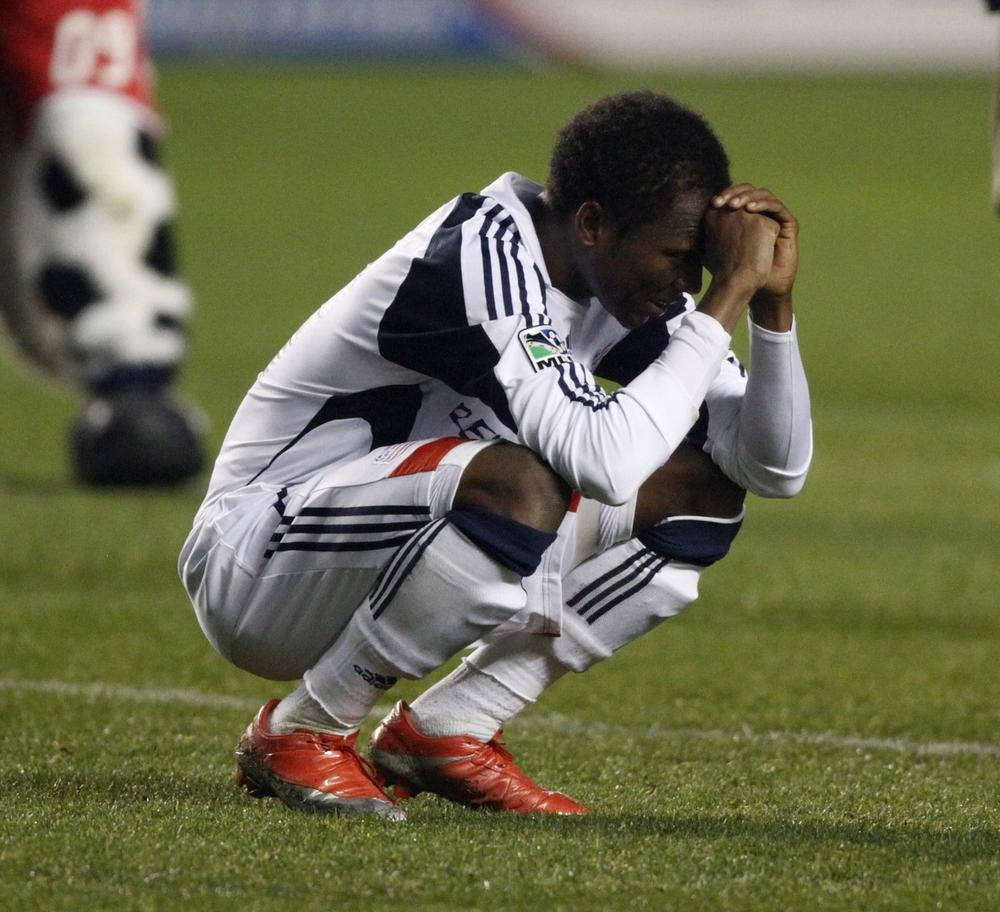 New England Revolution's Sainey Nyassi reacts to the Chicago Fire's 2-0 victory Saturday, in Bridgeview, Ill. (AP Photo/Jim Prisching)