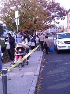 Hundreds wait outside Uphams Corner Health Clinic in Dorchester for the H1N1 vaccine. (Steve Brown/WBUR)
