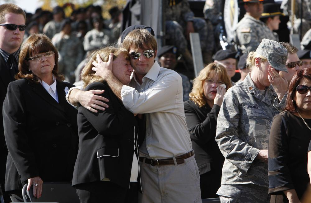 People in the crowd are emotional as they take their seats at a memorial service at Fort Hood, Texas, Tuesday, Nov. 10, 2009, where President Barack Obama spoke. (AP)