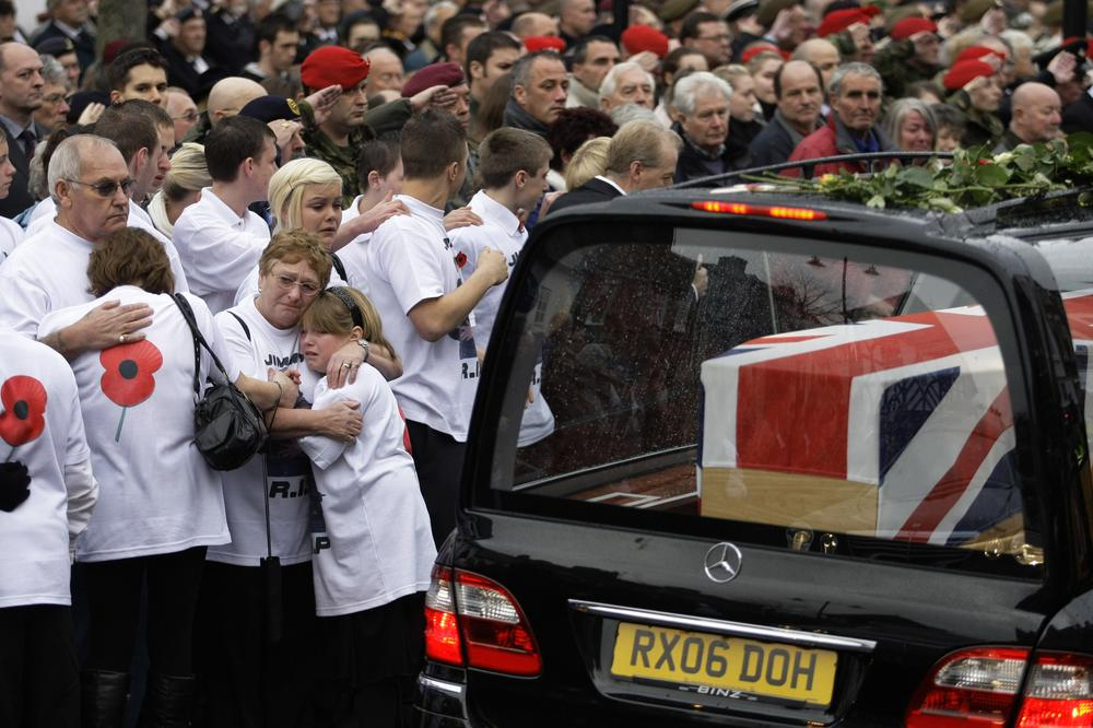 People react as the coffins of six British soldiers are driven through Wootton Bassett, England.  (AP)