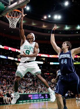 Rajon Rondo lays up the ball in front of Utah Jazz's Kyrylo Fesenko on Wednesday. (Michael Dwyer/AP)