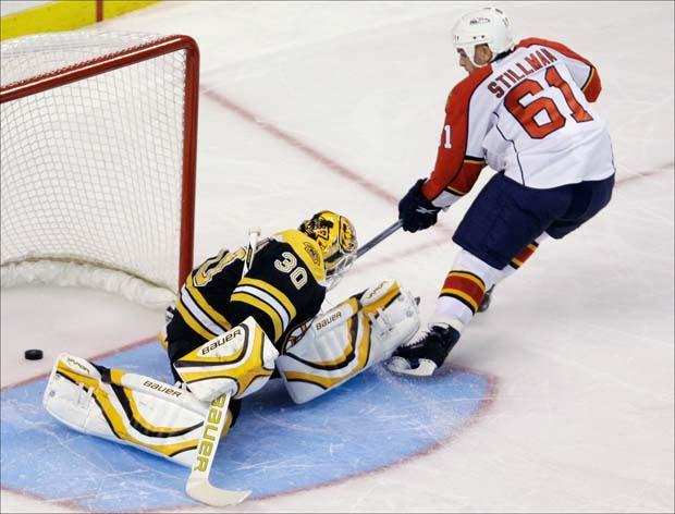 Florida Panthers left wing Corey Stillman pokes the puck past Bruins goalie Tim Thomas during the shootout for the only goal of the game on Thursday. (Charles Krupa/AP)