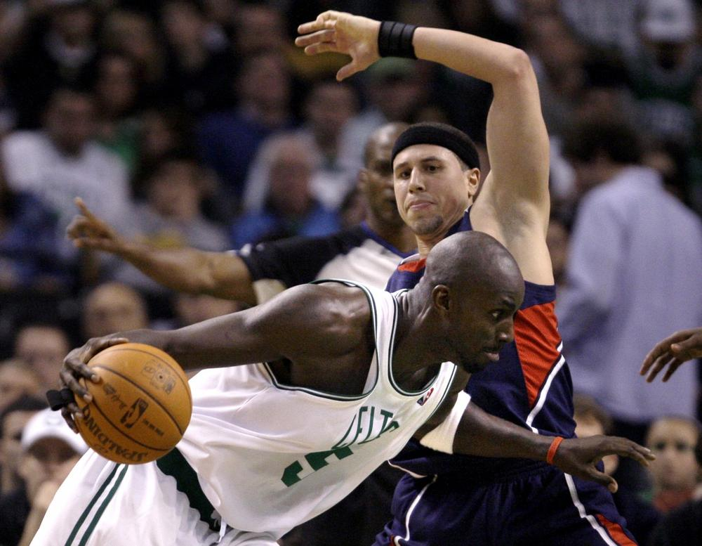Celtics forward Kevin Garnett, bottom, collides with Hawks guard Mike Bibby in the second half in Boston, Friday. (AP Photo/Charles Krupa)
