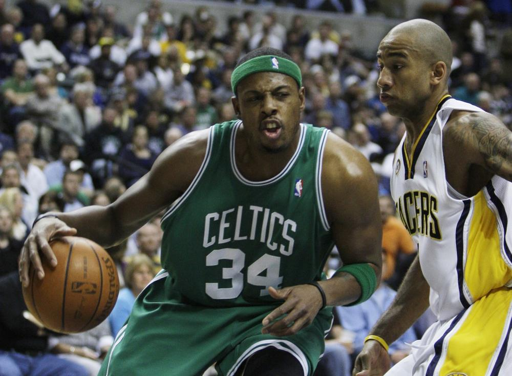 Celtics forward Paul Pierce, left, drives to the basket against Pacers guard Dahntay Jones during the first quarter in Indianapolis, Saturday. (AP Photo/Darron Cummings)