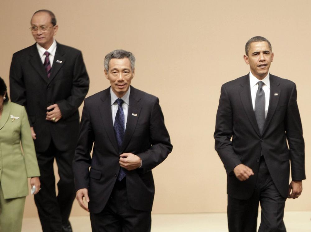 From left to right, Myanmar's Prime Minister Gen. Thein Sein, Singaporean Prime Minister Lee Hsien Loong and U.S. President Barack Obama, prepare to take their seats for a multilateral meeting with ASEAN-10 members in Singapore, Sunday. (AP Photo/Pablo Martinez Monsivais)