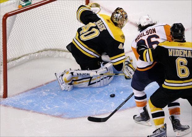 Goalie Tuukka Rask and New York Islanders left wing Matt Moulson watch a goal by Islanders' John Tavares during the third period on Monday. (Charles Krupa/AP)