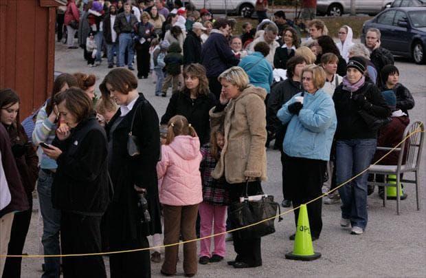People wait in line outside a clinic set up for swine flu inoculations in Worcester on Nov. 2. (AP)