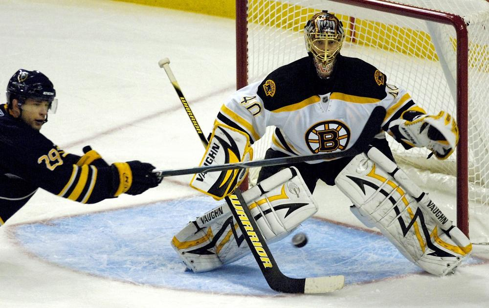 Sabres'  Jason Pominville, left, looks to redirect a shot at Bruins goalie Tuukka Rask during the third period in Buffalo, N.Y., Friday.  (AP Photo/Don Heupel)