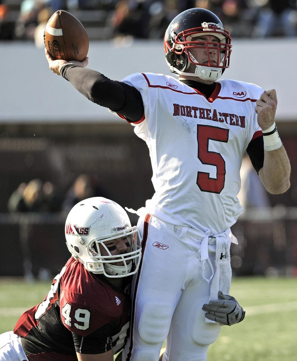 Northeastern quarterback Alex Dulski is sacked during the first half of an NCAA game earlier this month. Northeastern is dropping its football program after 74 years, saying it's too expensive to maintain. (AP)
