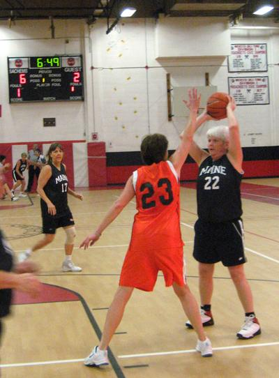A member of the Golden Cagers tries to block a shot by a Maine Flashes player in the Rock the Ages tournament. (Karen Given/Only A Game)