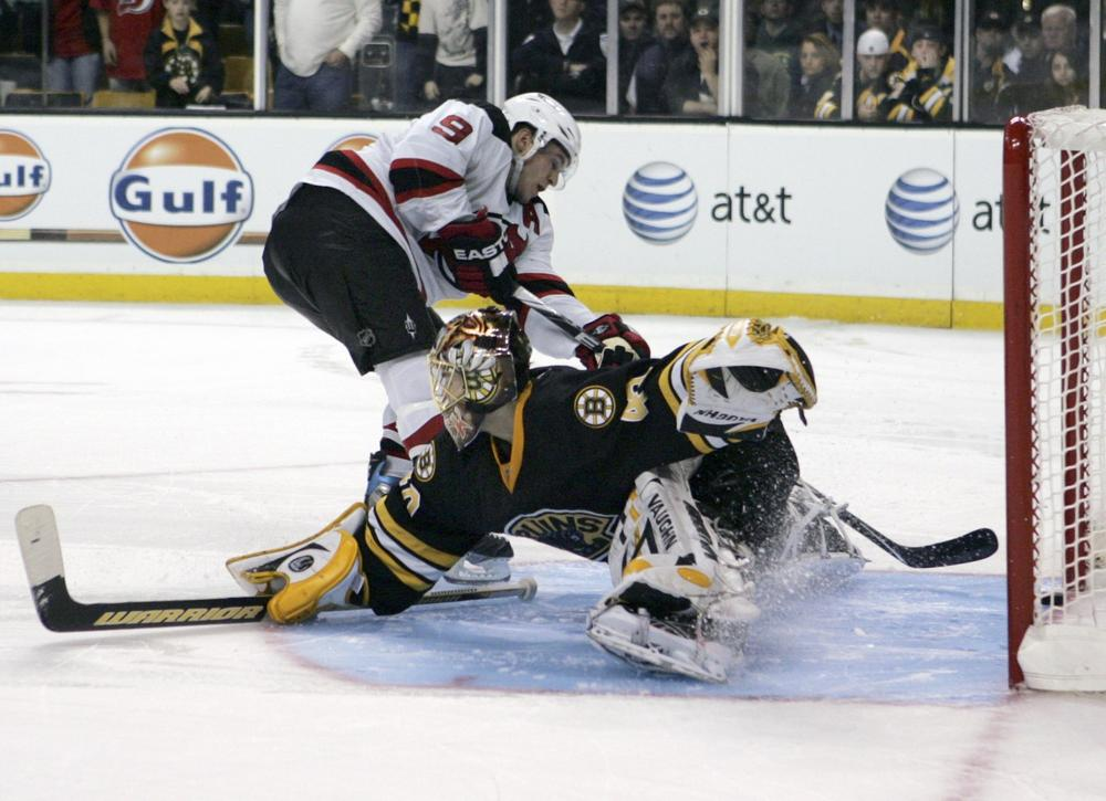 Devils' Zach Parise scores a shootout goal past  Bruins goalie Tuukka Rask  in Boston, Friday.  (AP Photo/Mary Schwalm)