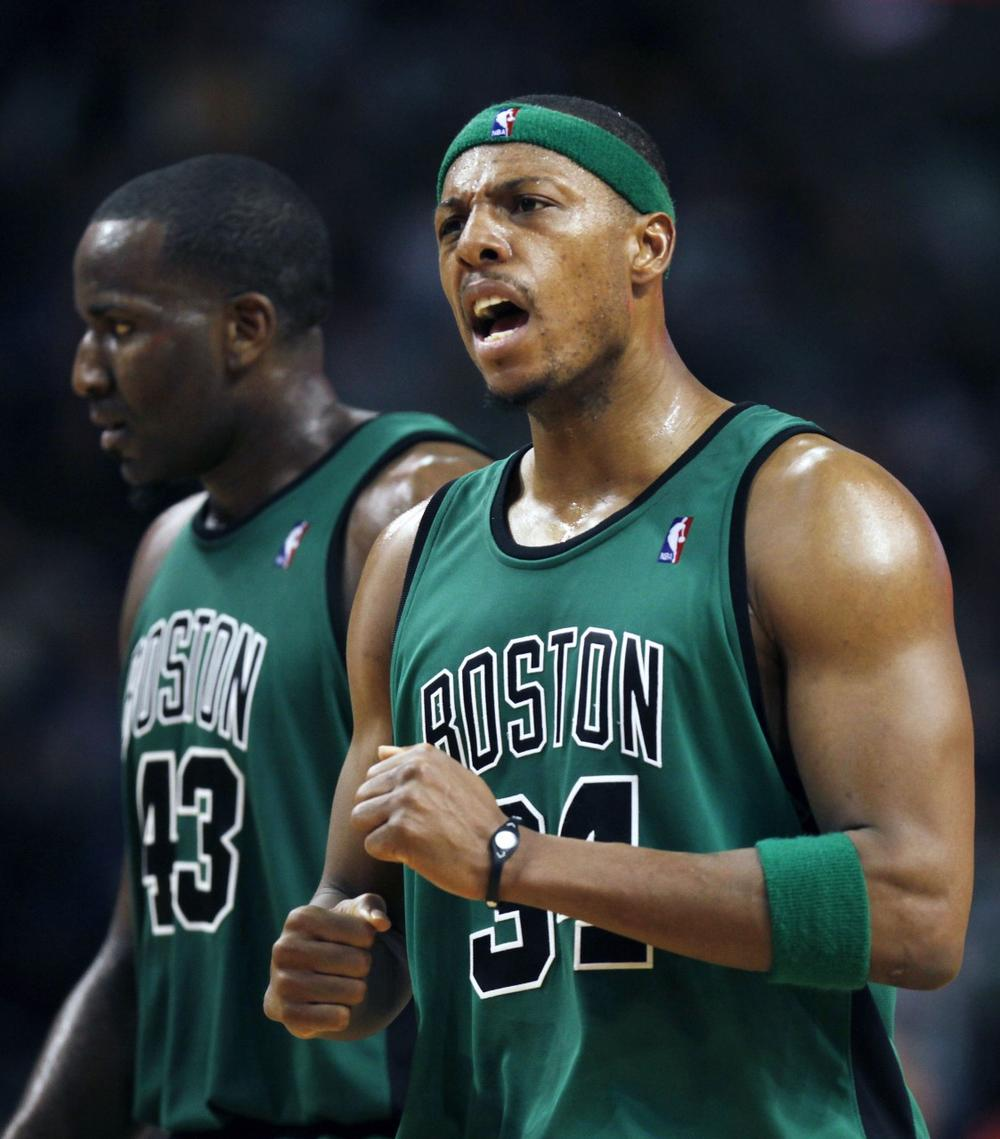 Celtics' Paul Pierce, right, reacts after a Celtics score, next to Kendrick Perkins in the third quarter against the Raptors, Friday in Boston.  (AP Photo/Michael Dwyer)