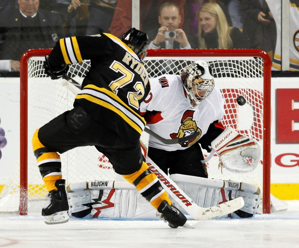 Bruins' Michael Ryder makes the only goal scored in the shootout on Ottawa Senators' Brian Elliott, Saturday, in Boston.  (AP Photo/Michael Dwyer)