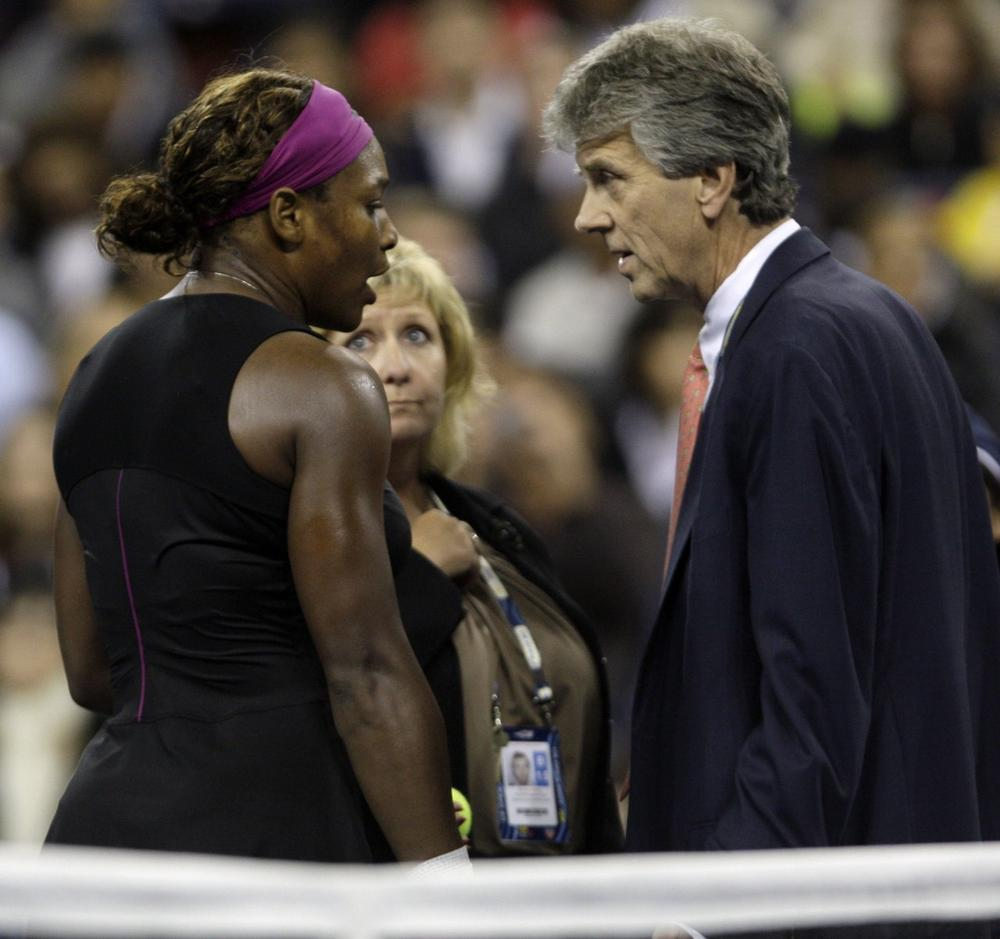 Serena Williams talks to officials after arguing with a line judge over a foot fault during her match against Kim Clijsters at the U.S. Open in September. (AP)