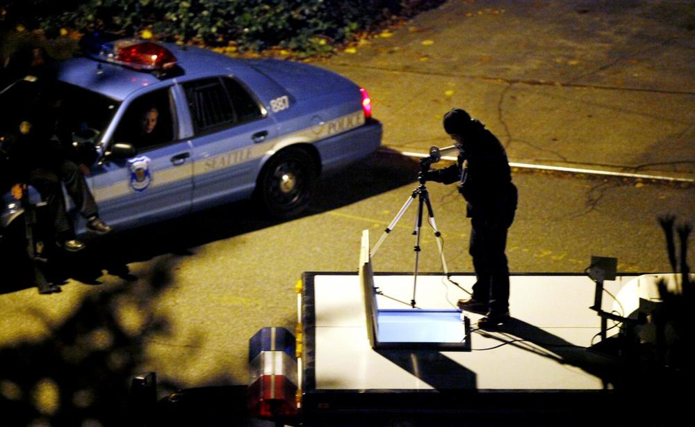 Police set up equipment atop a SWAT vehicle near a house police had surrounded during a search for Maurice Clemmons in the early morning hours Monday in Seattle. (Elaine Thompson/AP)