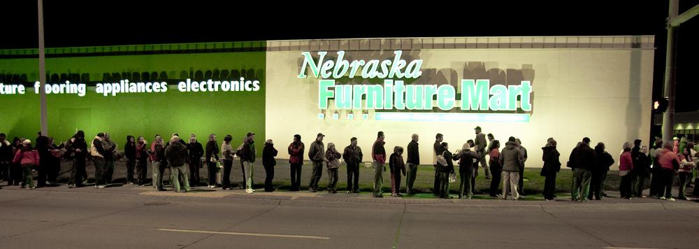 Shoppers form a line as they wait for the doors to open at the Nebraska Furniture Mart, in Omaha, Neb., Friday, Nov. 27, 2009, on Black Friday.(AP)