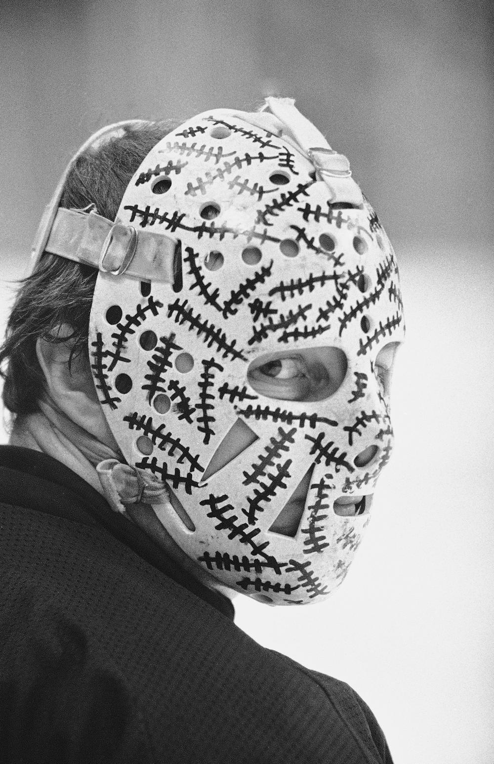 Gerry Cheevers, goalie for the Boston Bruins, in the face mask he decorated to represent the stitches he would have on his face had he been mask-less. May 1978. (AP)