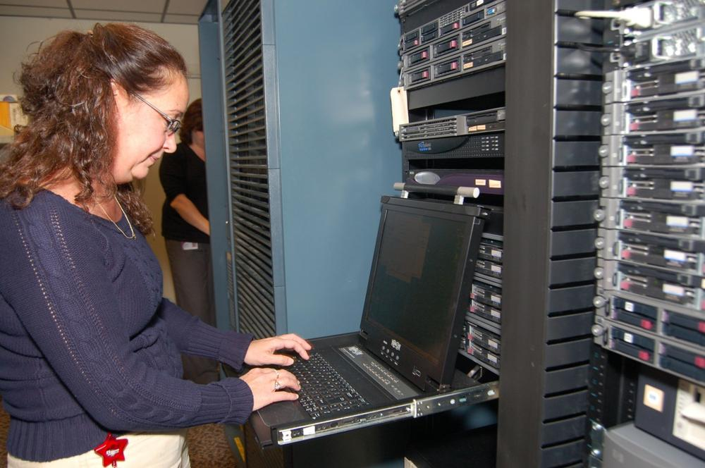 An IT worker at the Spencer-based manufactor Flexcon maintains computer systems critical to company operations. (Courtesy of Flexcon).