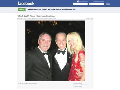 This screen grab from Michaele Salahi's Facebook page shows her and her husband Tareq with Vice President Joe Biden (center).